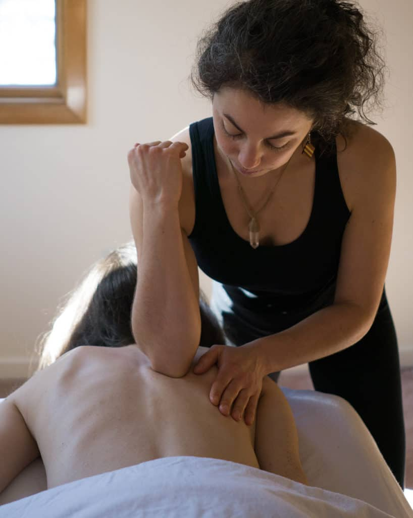 massaging with elbow on back